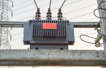 metal grid: High voltage transformer in the sky Stock Photo