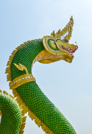 dragon with a green body statue  photo