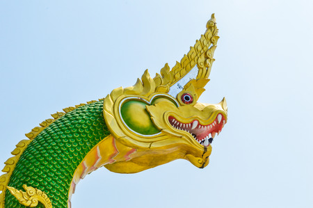 stair well: dragon with a green body statue