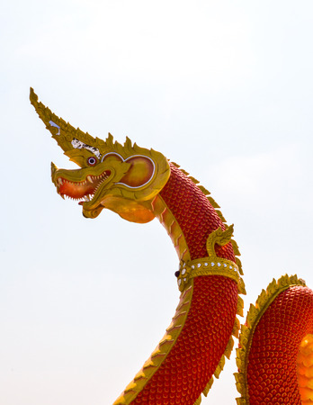 stair well: dragon with a red body statue