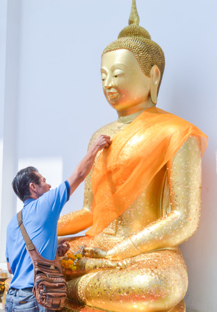 Gild the Buddha