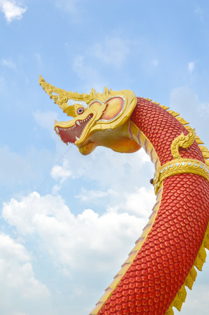 dragon with a red body statue  photo