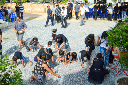 buddism: donate coin in funeral Thailand Editorial