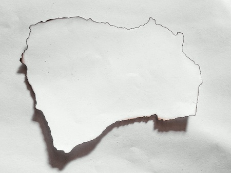 Structured white paper with burned edges