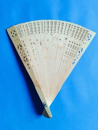 Hand fan in blue background Stok Fotoğraf