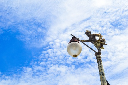 light poles with traditional Thai angle sculpture in the park photo