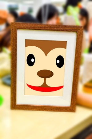 monkey face catoon in picture frame Stok Fotoğraf