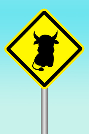 yellow sign beware of cow