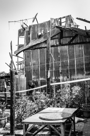 home destruction: black and white The house after a fire in country Thailand