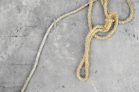 rope on wood wall Фото со стока