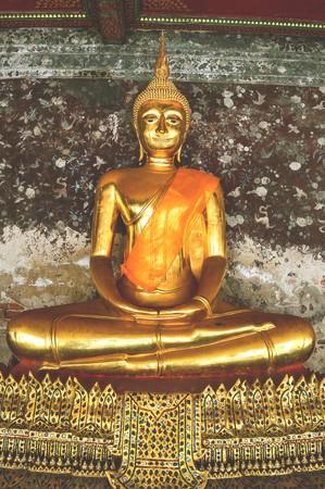 gold buddha statue in Wat Suthat Bangkok Thailand