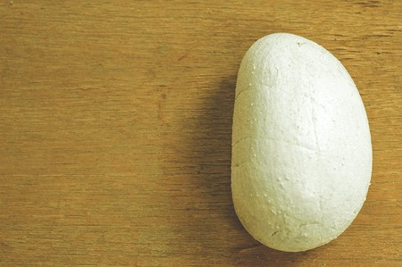 white stone on wood floor
