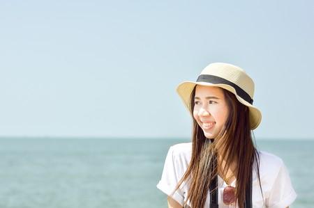 cute asia girl on the beach photo