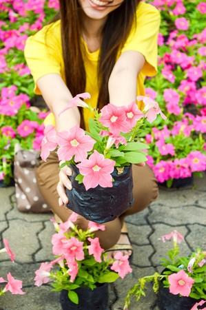 nautral: flower pot on girl hand