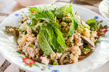 raw minced meat for thai food on a plate photo