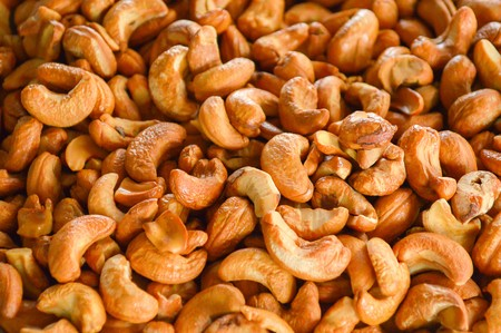 Cashew nuts arranged at the background Stock fotó