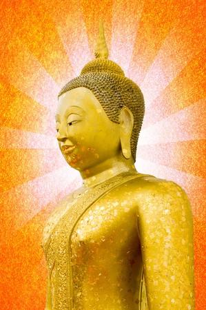 gold buddha statue on orange rays photo