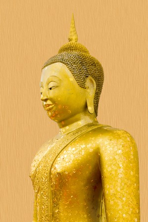 gold buddha statue on wooden wall photo