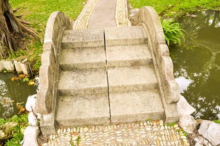 small cement bridge in garden 版權商用圖片