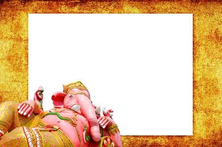 pink Ganesh statue on brown cement floor photo