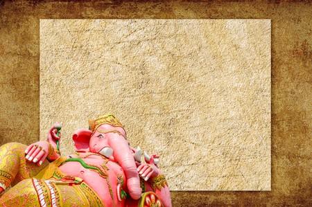 ganesh: pink Ganesh statue on brown cement floor Stock Photo