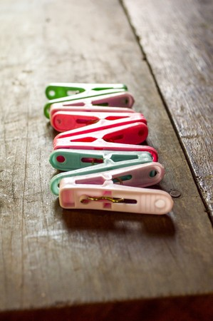 clothes pin: Clothes pin on wooden floor Stock Photo