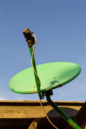 satellite dish: green satellite dish Stock Photo