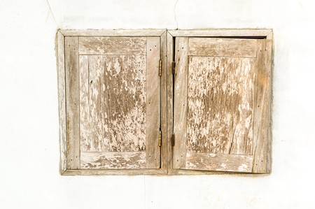 old wooden window on white cement wall photo