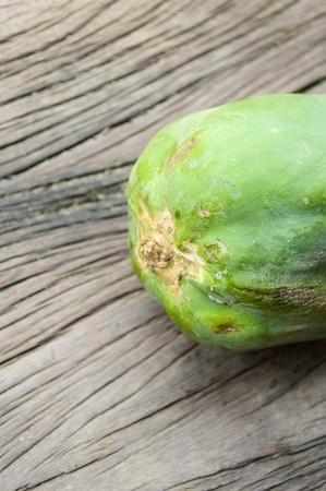 green papaya on wooden floor