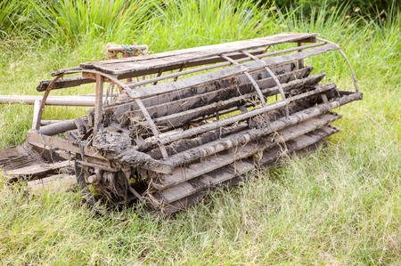 wooden Seat Walking tractor stained on green grass photo