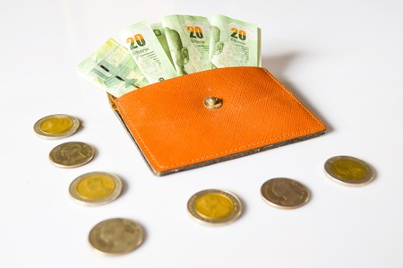 coin purses: Money in my bag on white background Stock Photo