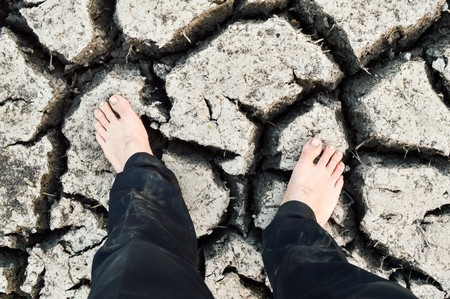 foot on cracked soil photo