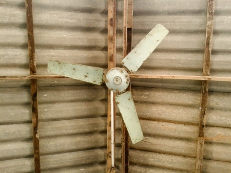 tile: Old fan hanging on roof