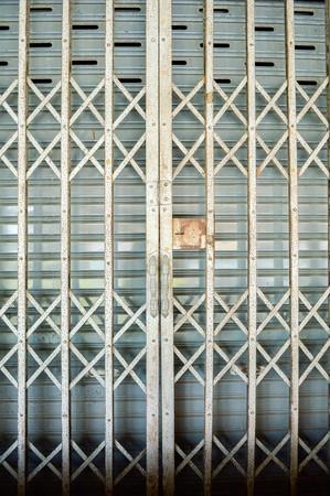 corrode: Antique slide steel locked door Stock Photo