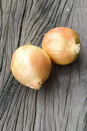 allium: Onion on wooden floor  Allium cepa Linn. Stock Photo