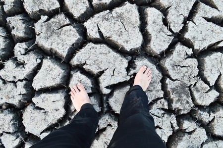 foot man on cracked soil in country Thailand photo
