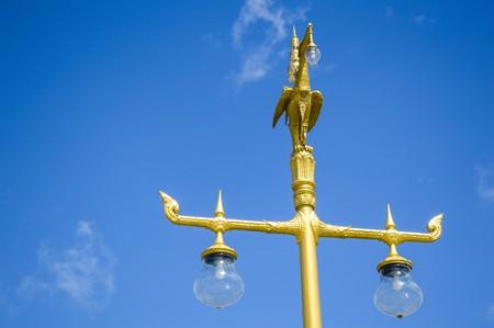 household fixture: Light pole sculpture Swan creature holding lamp Stock Photo