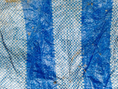 matiere plastique: Plastic material in white and blue stripes as background