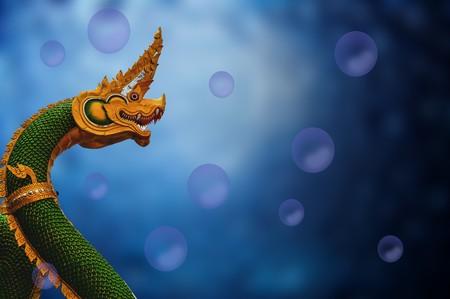 King of Naga statue on blur blue background Stock Photo