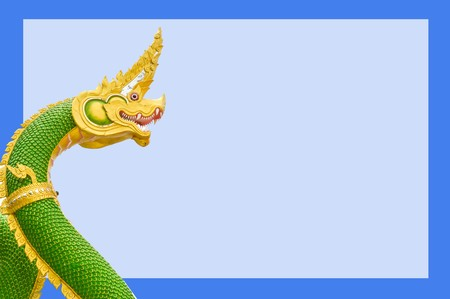 green nagas statue on blue background