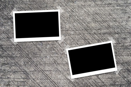 photo papers on clean cement wall background