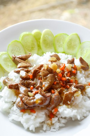 spicy chicken liver fried on hot rice Thailand healthy food Stock Photo