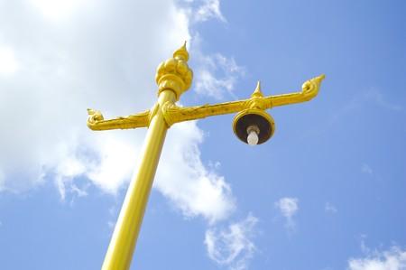 gold street lamp post in garden