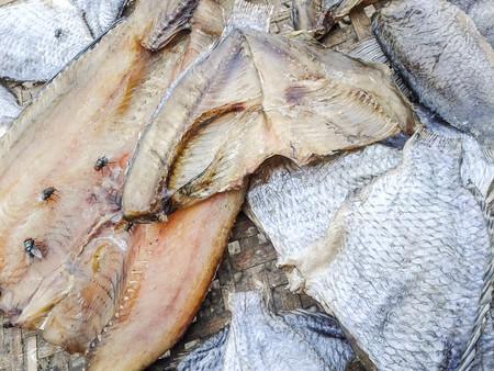 mango fish: Dry salted fish on bamboo floor