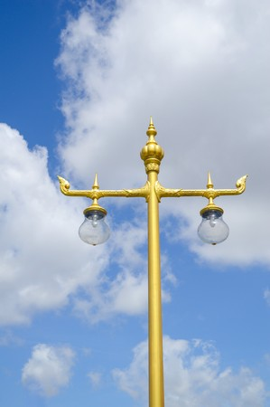 lamp on the pole: gold lamp pole on blue sky Stock Photo
