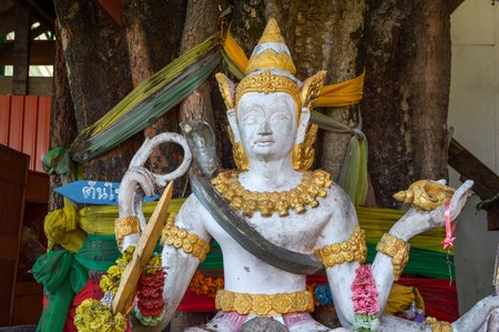 angle statue in public temple Thailand Imagens