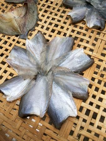 moonbeam: dry fish raw food on bamboo floor Stock Photo
