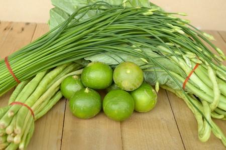 green vegetable: green vegetable on wood plank