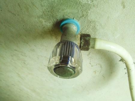close up old shower knob