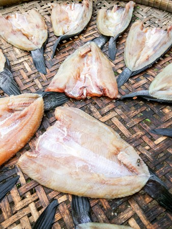 nilotica: Dry salted fish on bamboo floor